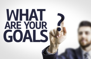 Business man pointing the text: What are Your Goals?